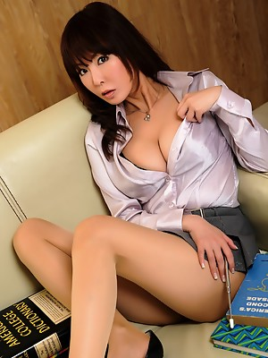 Asian secretary is tired of working and wants to play