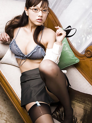 Charming gravure idol cutie allures in her sexy business suit