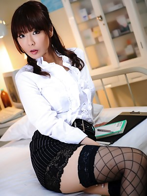 Asian hottie shows off her sexy stockings